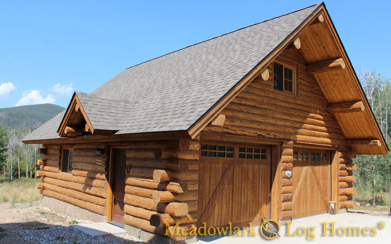 Garages and barns meadowlark log homes for Log barn homes