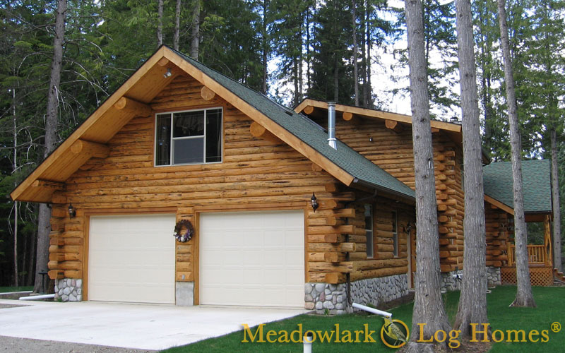 Garages and barns meadowlark log homes for House plans with attached shop